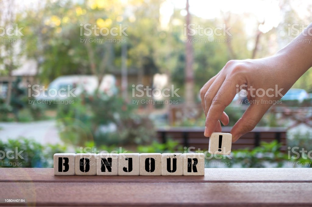 BONJOUR ! Concept with Hand and alphabet blocks stock photo