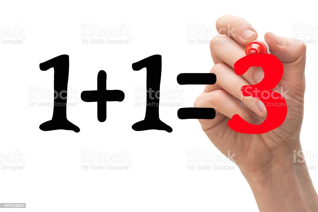 1+1=3 concept with hand writing down the number '3' in red marker pen. stock photo