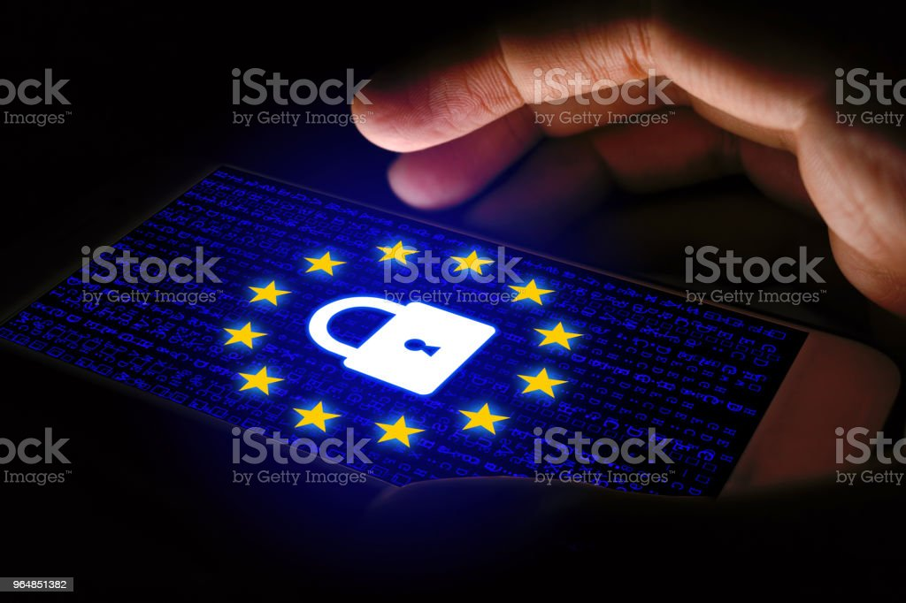 GDPR Concept with man using smartphone and lock icon on virtual screen. royalty-free stock photo