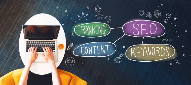 seo concept with person using a laptop - dictionary stock pictures, royalty-free photos & images