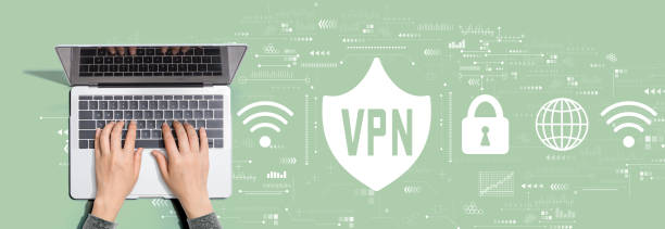 VPN concept with person using laptop computer VPN concept with person using a laptop computer vpn stock pictures, royalty-free photos & images