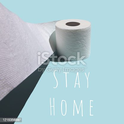 istock Concept with toilet paper. Against a blue background with a stiff shadow 1215356597