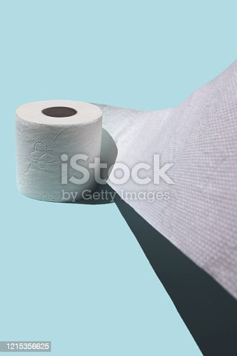 istock Concept with toilet paper. Against a blue background with a stiff shadow 1215356625