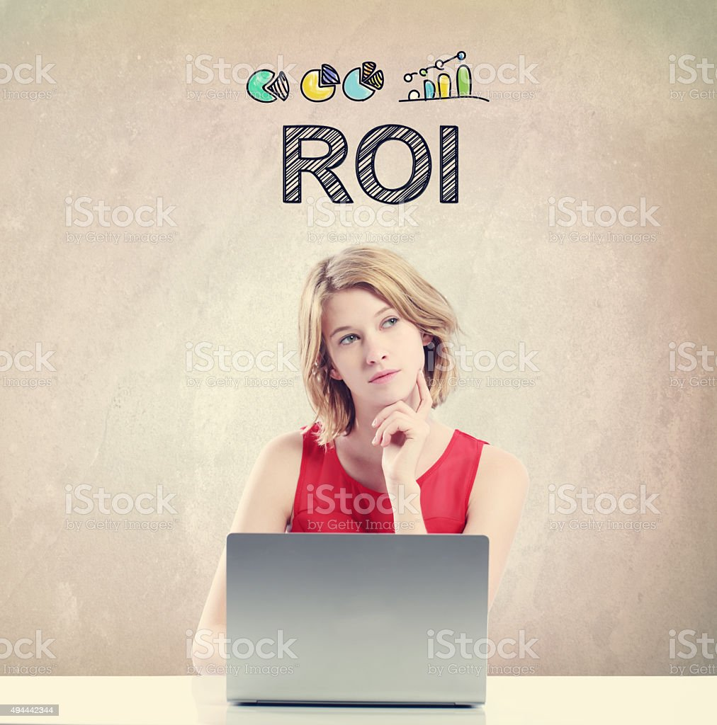 ROI concept with woman working on a laptop stock photo