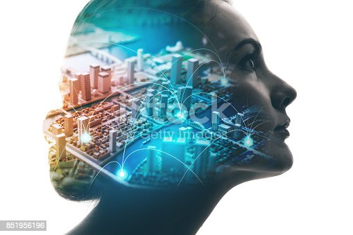 istock AI(Artificial Intelligence) concept. Woman profile and smart city. Mixed media. 851956196