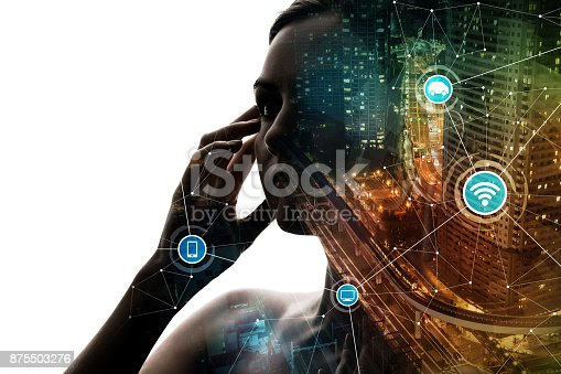 istock AI(Artificial Intelligence) concept. Woman profile and smart city. Mixed media. 875503276