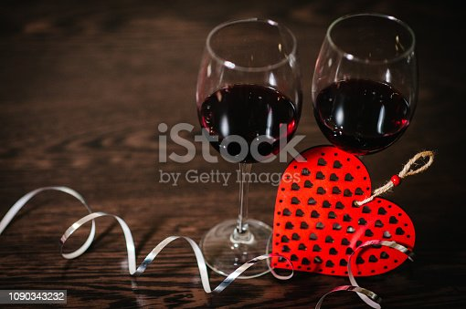 istock Concept Women's Day, eighth of March. A romantic love concept holiday, ribbons, wine, red hearts on brown wooden background. Place for text. Wedding, jubilee. St. Valentine's Day. 1090343232