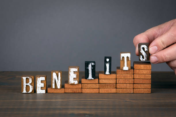 BENEFITS concept. Wooden alphabet letters on steps stock photo