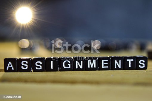 istock ASSIGNMENTS concept wooden blocks on the table 1083635548