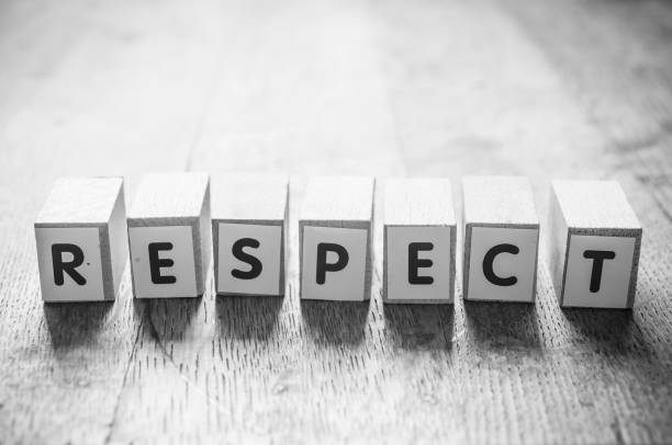 concept word on cube - respect concept word on cube on wooden desk - respect dignity stock pictures, royalty-free photos & images