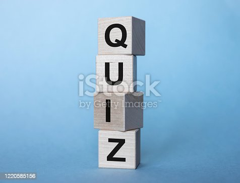 istock concept word QUIZ on cubes on a light blue background 1220585156