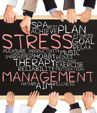 Photo of business hands holding blackboard and writing STRESS MANAGEMENT concept