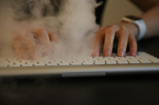 Concept Workaholic Smoke Over Keyboard Stock Photo - Download Image Now -  iStock