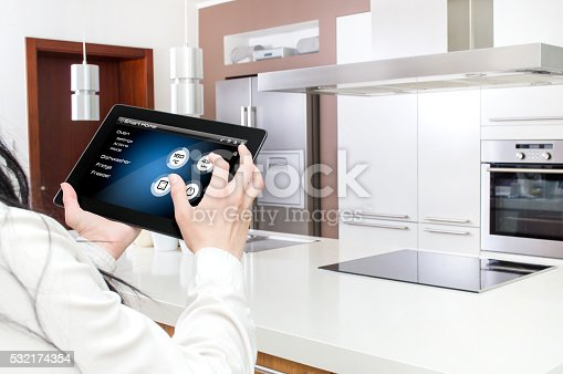 istock Conception of smart kitchen controlled by tablet application. 532174354