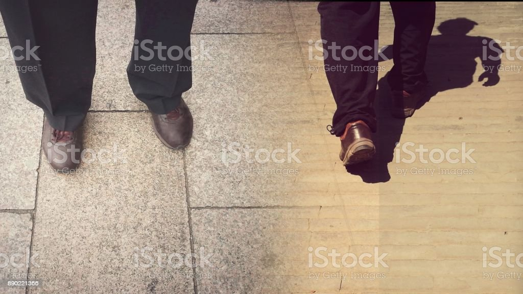 Concepts of continue or quit; stay or walk away; stop or go. stock photo