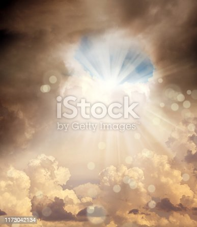 conceptual abstract cloudscape image of stormy sky with beam of light