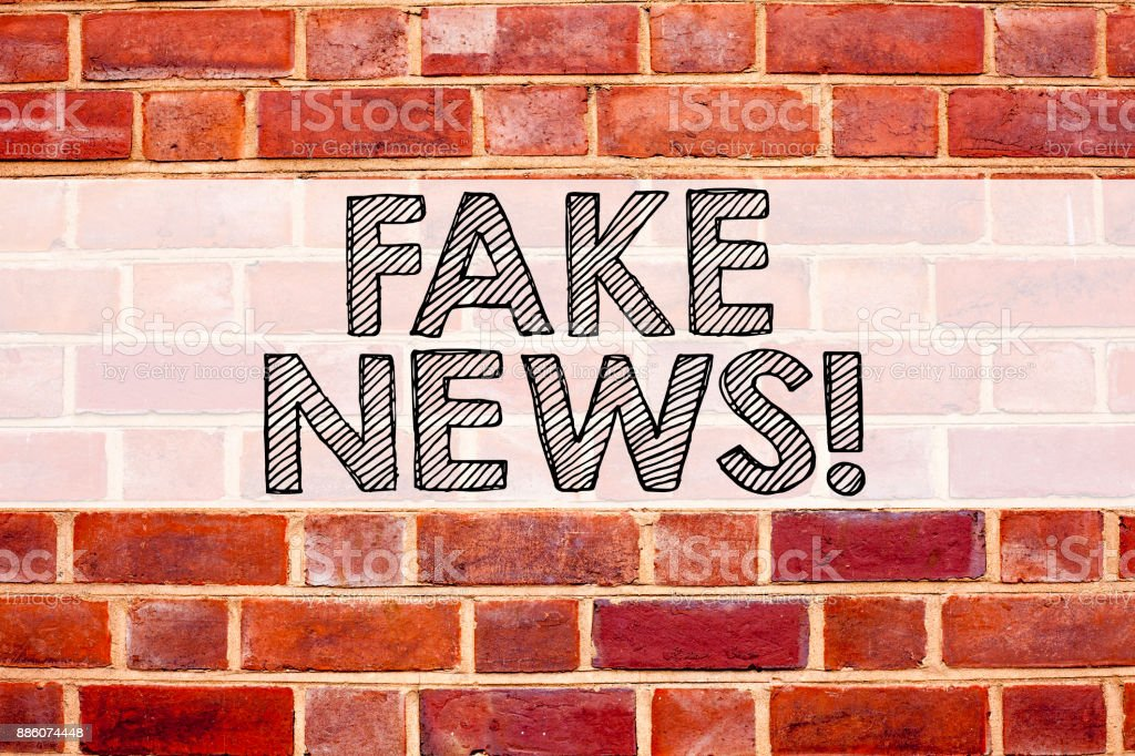 Conceptual announcement text caption inspiration showing Fake News. Business concept for Propaganda Newspaper Fake News written on old brick background with copy space stock photo