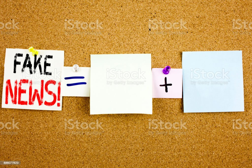 Conceptual announcement text caption inspiration showing Fake News Business concept for Propaganda Newspaper Fake News written on Sticky Note on cork background with copy space stock photo