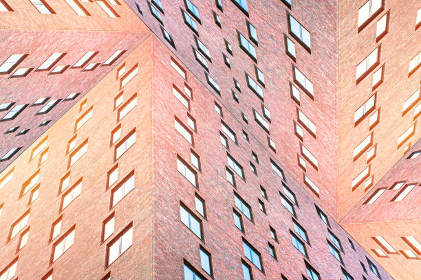 Conceptual architecture texture of modern brick buildings with many square windows. stock photo