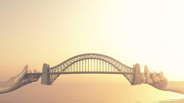 Conceptual bridge over water. stock photo