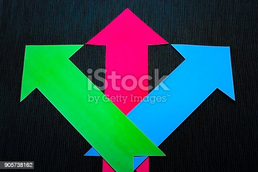 157434064 istock photo conceptual colored arrows on the dark blue texture background 905738162