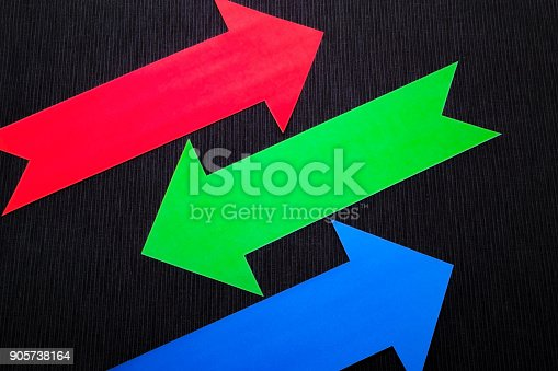 157434064 istock photo conceptual colored arrows on the dark blue texture background 905738164