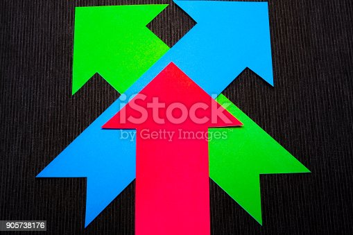 157434064 istock photo conceptual colored arrows on the dark blue texture background 905738176