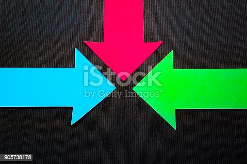 157434064 istock photo conceptual colored arrows on the dark blue texture background 905738178