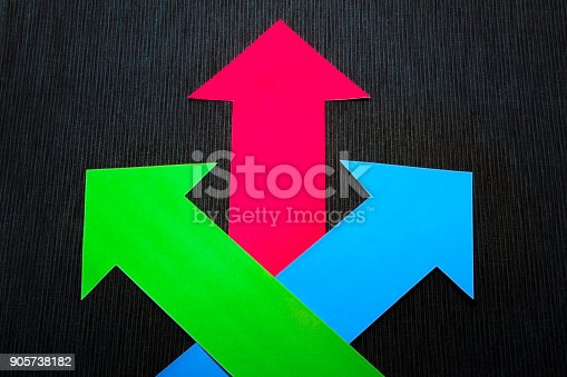 157434064 istock photo conceptual colored arrows on the dark blue texture background 905738182