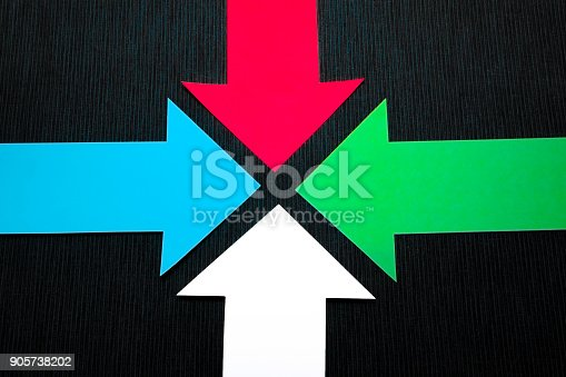 157434064 istock photo conceptual colored arrows on the dark blue texture background 905738202