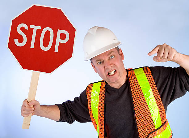 Conceptual Construction Worker Asking to Stop Doing Something stock photo