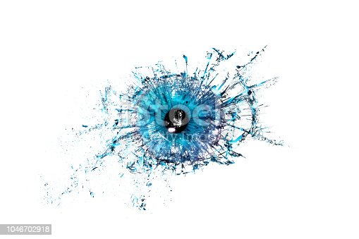 istock Conceptual creative photo of a blue human eye close-up macro that breaks into small pieces of glass isolated on a white background. 1046702918