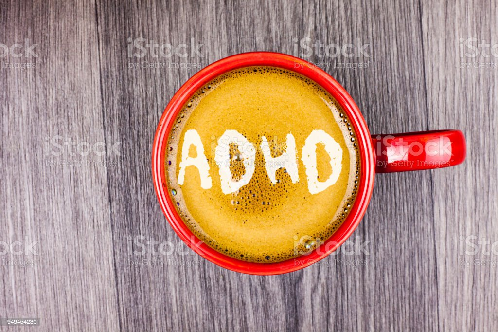 Conceptual hand writing showing Adhd. Business photo text Learning made easier for children teaching no more a difficult task written on Coffee in Red Cup on Grey wooden background. Top view. stock photo