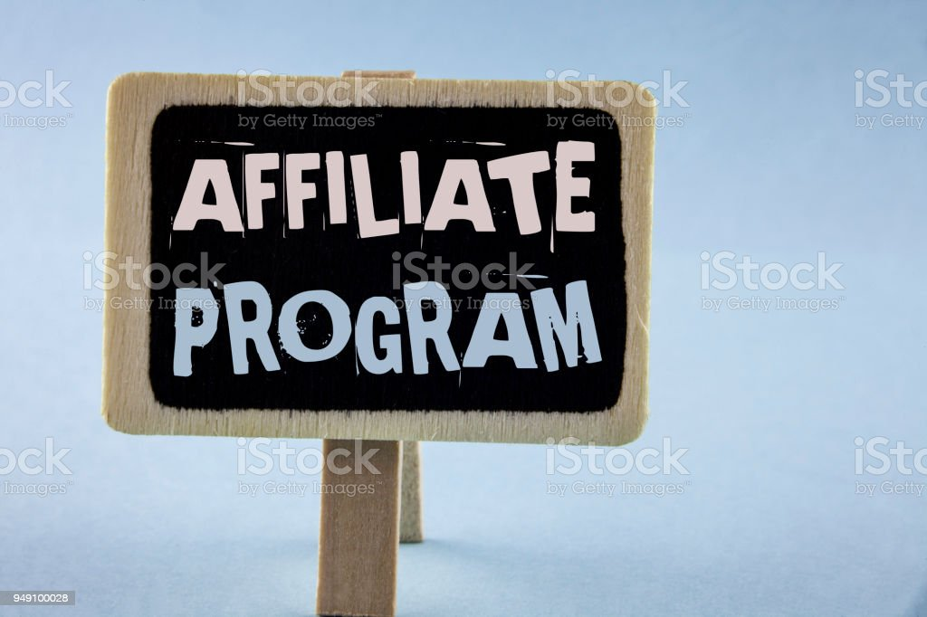 Conceptual hand writing showing Affiliate Program. Business photo showcasing software link songs apps books and sell them to earn money written on Wooden Notice Board plain background. stock photo