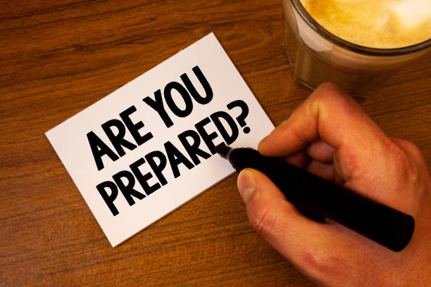Conceptual hand writing showing Are You Prepared Question. Business photo text Ready Preparedness Readiness Assessment Evaluation Text white paper hand black marker coffee glass letter. stock photo