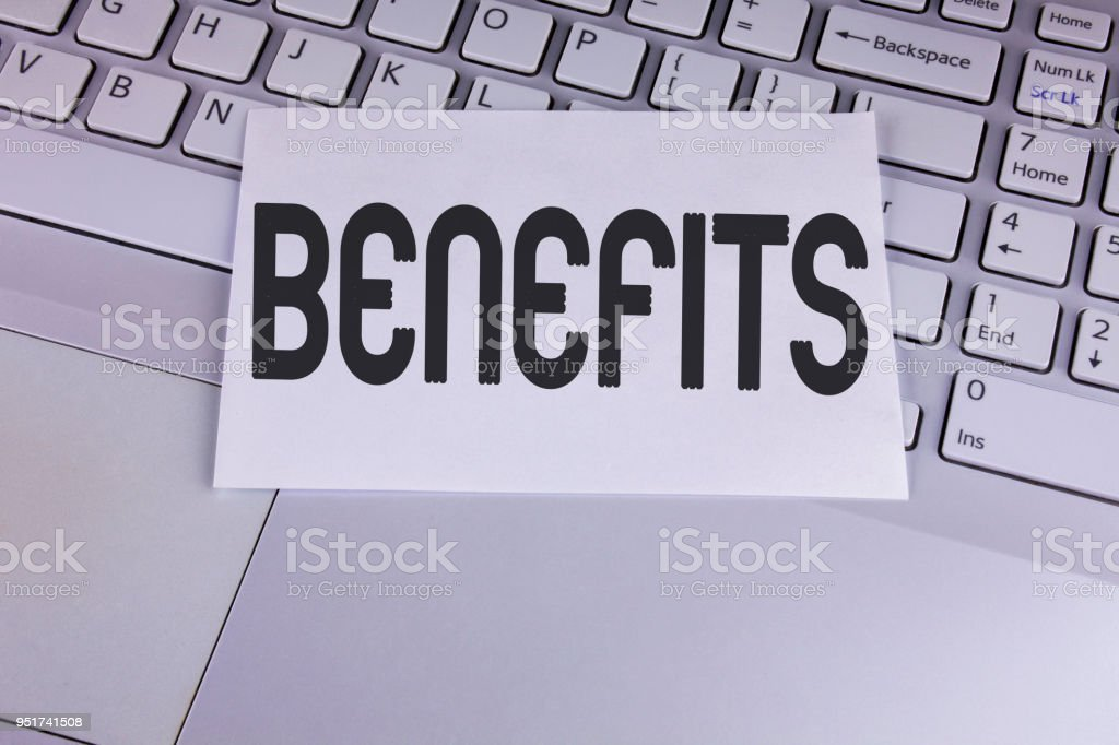 Conceptual hand writing showing Benefits. Business photo showcasing hike in allowance for senior employees of the company written on White Sticky Note Paper placed on the Laptop. stock photo