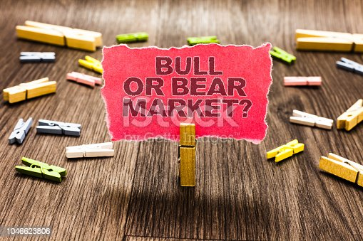 Conceptual hand writing showing Bull Or Bear Market question. Business photo text asking someone about his marketing method Clips spread woody table learn study things class schooling