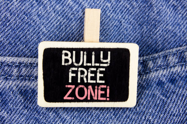 Conceptual hand writing showing Bully Free Zone Motivational Call. Business photo text creating abuse free school college life written on Wood Piece on the Jeans background. Conceptual hand writing showing Bully Free Zone Motivational Call. Business photo text creating abuse free school college life written Wood Piece the Jeans background. prettige verrassingen stock pictures, royalty-free photos & images