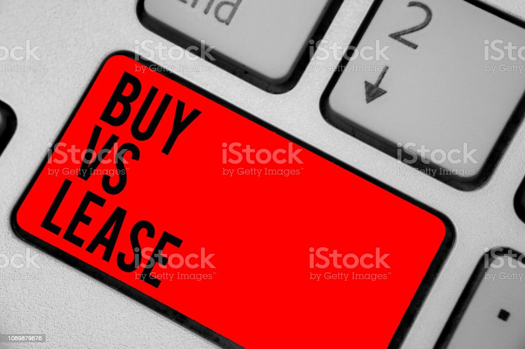 Conceptual hand writing showing Buy Vs Lease. Business photo text Own something versus borrow it Advantages Disadvantages Keyboard red key create computer computing reflection document. stock photo