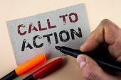 istock Conceptual hand writing showing Call To Action. Business photo text most important part of online digital marketing campaign written by Man with Marker on Cardboard Piece on plain background 946568698