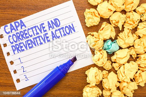 istock Conceptual hand writing showing Capa Corrective And Preventive Action. Business photo text Elimination of nonconformities 1049736544