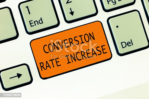 1131526784 istock photo Conceptual hand writing showing Conversion Rate Increase. Business photo text Ratio of Total Visitors who perform desired actions 1039929658