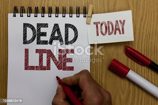 Conceptual hand writing showing Dead Line. Business photo text Period of time by which something must be finished or accomplished Man holding marker notebook wooden table for today coffee cup
