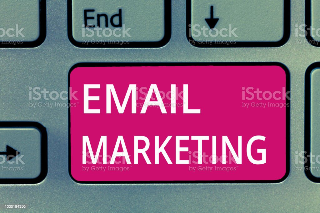 Conceptual hand writing showing Email Marketing. Business photo showcasing Sending a commercial message to a group of people using mail stock photo