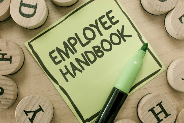 Conceptual hand writing showing Employee Handbook. Business photo showcasing Document that contains an operating procedures of company stock photo