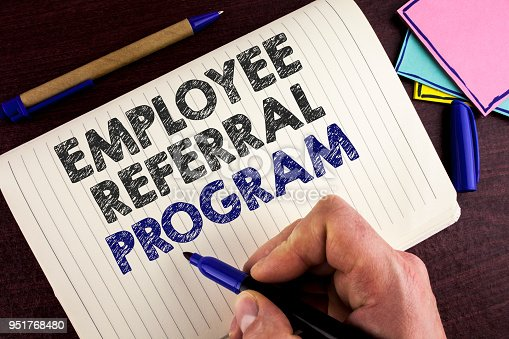 istock Conceptual hand writing showing Employee Referral Program. Business photo showcasing Recommend right jobseeker share vacant job post written by Man on Notebook Book on wooden background Pen. 951768480