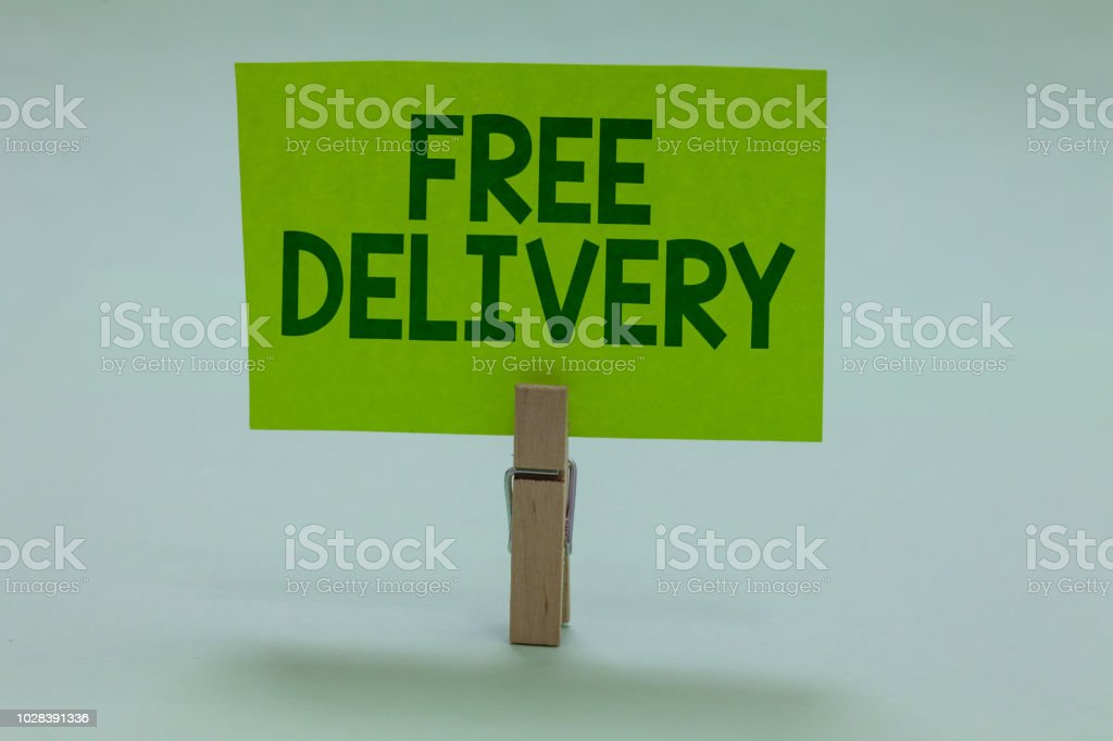 Conceptual hand writing showing Free Delivery. Business photo showcasing Shipping Package Cargo Courier Distribution Center Fragile Clothespin holding green paper important message ideas stock photo
