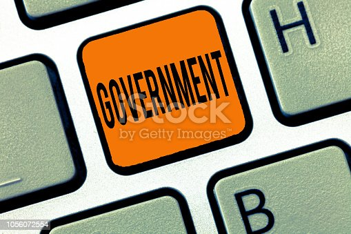 istock Conceptual hand writing showing Government. Business photo text Group of showing with authority to govern country state company 1056072554