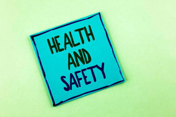 Conceptual hand writing showing Health And Safety. Business photo showcasing being in good condition harmless Workouts Healthy food written on Sticky Note Paper on the plain background. stock photo