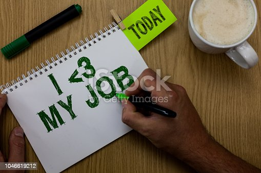 465474428 istock photo Conceptual hand writing showing I love My Job. Business photo showcasing telling someone that you admire your current profession Man holding marker notebook reminder wooden table cup coffee. 1046619212